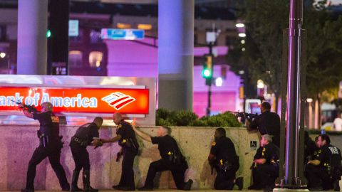 """Police respond after shots were fired in downtown Dallas on Thursday, July 7. <a href=""""http://www.cnn.com/2016/07/08/us/philando-castile-alton-sterling-protests/index.html"""" target=""""_blank"""">Five police officers were fatally shot </a>during a protest over recent police shootings in Louisiana and Minnesota. Seven other officers were injured in the ambush, as were two civilians."""