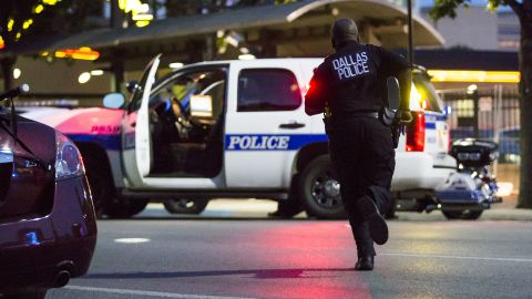 Dallas police respond to the scene of the shootings.