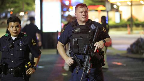 Dallas police stand near the scene where four Dallas police officers were shot and killed on July 7.