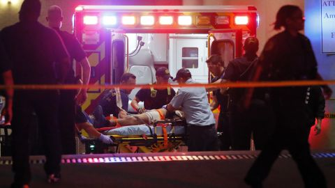 Emergency responders administer CPR to an unknown patient near the receiving area of the Baylor University Medical Center.