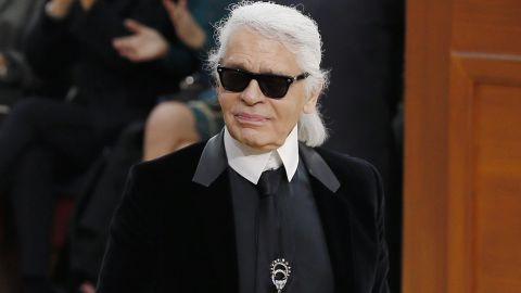 German fashion designer Karl Lagerfeld acknowledges the public during the Chanel 2015-2016 fall/winter ready-to-wear collection fashion show on March 9, 2015 at the Grand Palais in Paris.   AFP PHOTO / PATRICK KOVARIK        (Photo credit should read PATRICK KOVARIK/AFP/Getty Images)