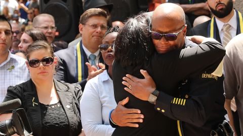 Dallas Police Chief David Brown is greeted with a hug at a prayer vigil following the deaths of five police officers last night during a Black Live Matter march on July 8, 2016 in Dallas, Texas. Five police officers were killed and seven others were injured  in a coordinated ambush at a anti-police brutality demonstration in Dallas. Investigators are saying the suspect is 25-year-old Micah Xavier Johnson of Mesquite, Texas. This is the deadliest incident for U.S. law enforcement since September 11.