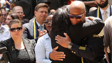DALLAS, TX - JULY 08:  Dallas Police Chief David Brown is greeted with a hug at a prayer vigil following the deaths of five police officers last night during a Black Live Matter march on July 8, 2016 in Dallas, Texas. Five police officers were killed and seven others were injured  in a coordinated ambush at a anti-police brutality demonstration in Dallas. Investigators are saying the suspect is 25-year-old Micah Xavier Johnson of Mesquite, Texas. This is the deadliest incident for U.S. law enforcement since September 11.  (Photo by Spencer Platt/Getty Images)