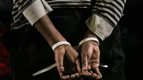 OAKLAND, CA - DECEMBER 13: The hands of a black protester are seen following his arrest at a 'Millions March' demonstration protesting the killing of unarmed black men by police on December 13, 2014 in Oakland, California. The march was one of many held nationwide. (Photo by Elijah Nouvelage/Getty Images)