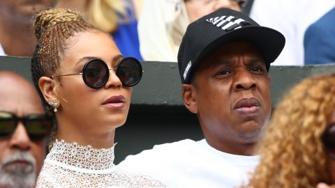 Star quality: Jay Z and Beyonce watch on as Williams and Kerber battle it out in the women's singles final.