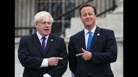 Cameron stands beside the then London Mayor Boris Johnson as the Olympic cauldron is lit for the Paralympic Games on August 24, 2012 in London.