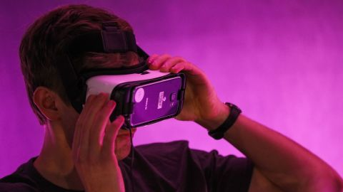A guest tests out Minecraft for VR Gear, while wearing Oculus goggles, during demonstration of the Minecraft for Gear VR at The Village event space in San Francisco, California on March 15, 2016.  / AFP / GABRIELLE LURIE        (Photo credit should read GABRIELLE LURIE/AFP/Getty Images)
