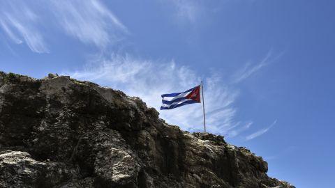 A Cuban flag flutters on top of a rock near the U.S. Embassy in Havana on August 13, 2015.