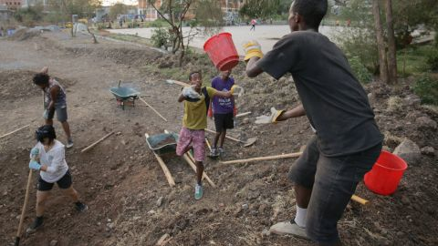 Pictured here, local kids help with the construction of the new skate park.