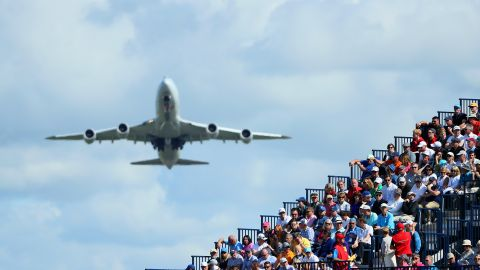 TROON, SCOTLAND - JULY 14:  A plane flies over a grandstand next to the 8th green during the first round on day one of the 145th Open Championship at Royal Troon on July 14, 2016 in Troon, Scotland.  (Photo by Andrew Redington/Getty Images)