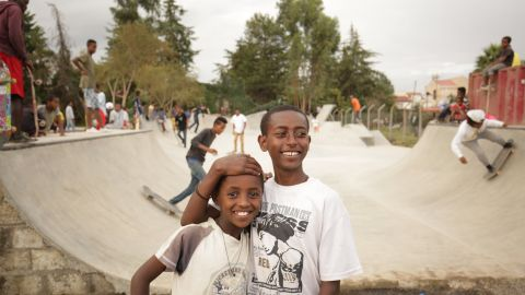 Young skaters hang out inside the new Addis skate park. The local community in Addis Ababa learned from and worked alongside a team of over 60 volunteers from over 20 countries to build the park.