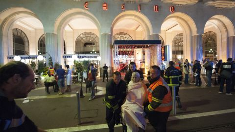 Wounded people are evacuated from the scene where the truck drove into the crowd during the Bastille Day celebrations.