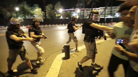 Armed French police move people away from the Promenade des Anglais in Nice in the aftermath of Thursday's attack.