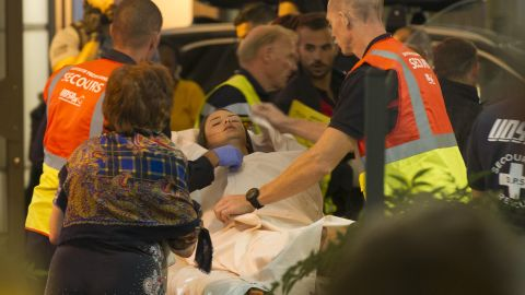 Emergency teams assist wounded people at the scene.