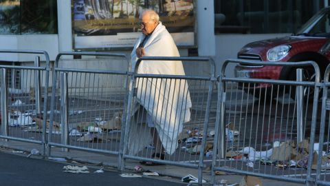 A man looks at the scene of the attack on the Promenade des Anglais.