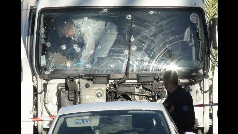 Forensics investigators examine a truck at the scene of the attack.