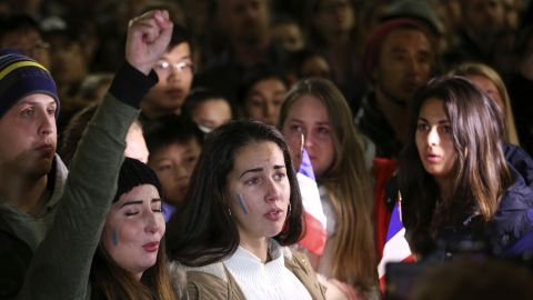 People sing the French national anthem at a July 15 vigil in Sydney.