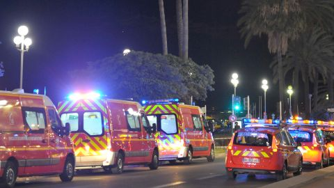 """Fire department ambulances and vehicles are parked near the scene of an attack after a truck drove on to the sidewalk and plowed through a crowd of revelers who'd gathered to watch the fireworks in the French resort city of Nice, southern France, Friday, July 15, 2016. A spokesman for France's Interior Ministry says there are likely to be """"several dozen dead"""" after a truck drove into a crowd of revelers celebrating Bastille Day in the French city of Nice. (AP Photo/Christian Alminana)"""