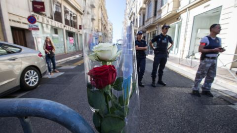 Security personnel stand guard near Nice's Promenade des Anglais.