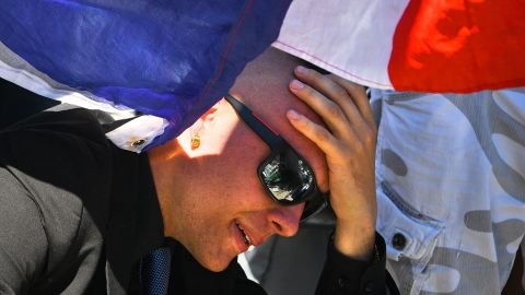 A man reacts as people visit the scene and lay tributes to the victims of a terror attack on the Promenade des Anglais on Friday July 15 in Nice, France.