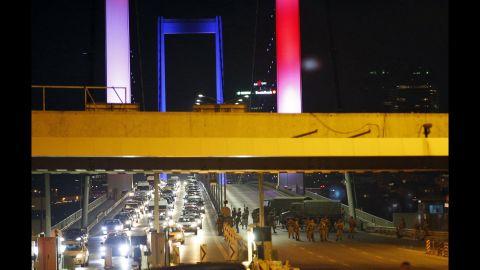 Turkish soldiers block Istanbul's iconic Bosphorus Bridge.<br />