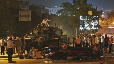"""Tanks move into position as Turkish people attempt to stop them, in Ankara, Turkey, early Saturday, July 16, 2016. Turkey's armed forces said it """"fully seized control"""" of the country Friday and its president responded by calling on Turks to take to the streets in a show of support for the government. A loud explosion was heard in the capital, Ankara, fighter jets buzzed overhead, gunfire erupted outside military headquarters and vehicles blocked two major bridges in Istanbul."""
