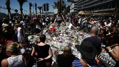 People gather and lay tributes on the Promenade des Anglais on July 16, 2016 in Nice, France.