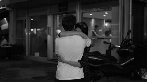Two people embrace. Near the Promenade des Anglais, Sanguinetti says people were hugging and leaving flowers.