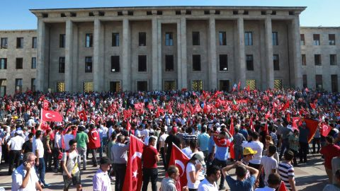People gather outside the Turkish Parliament  in Ankara during an extraordinary session after the failed coup attempt.