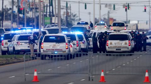 BATON ROUGE, LA - JULY 17:  East Baton Rouge Police officers patrol Airline Hwy after 3 police officers were killed early this morning on July 17, 2016 in Baton Rouge, Louisiana. According to reports, one suspect has been killed while others are still being sought by police.  (Photo by Sean Gardner/Getty Images)