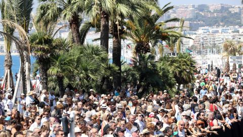 Thousands gather to observe a minute of silence at noon Monday on Nice's Promenade des Anglais.