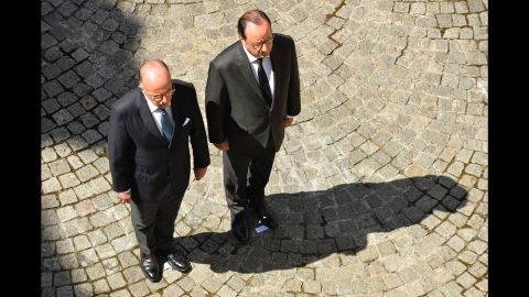 French President Francois Hollande, right, and Interior Minister Bernard Cazeneuve take part in the observation of a minute's silence on July 18 at the Interior Ministry in Paris.