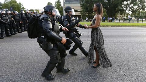 """Protester Ieshia Evans is detained by law enforcement officers near the police headquarters in Baton Rouge, Louisiana, on Saturday, July 9. Evans was among dozens of people protesting <a href=""""http://www.cnn.com/2016/07/07/us/baton-rouge-alton-sterling-shooting/"""" target=""""_blank"""">the death of Alton Sterling,</a> who was fatally shot by police just a few days earlier. Click through the gallery to see memorable images from other protests throughout history."""