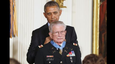President Barack Obama presents the Medal of Honor to retired Army Lt. Col. Charles Kettles, 86, of Ypsilanti, Michigan, during a ceremony in the East Room of the White House in Washington July 18. Kettles displayed extraordinary daring and bravery when he landed his helicopter in the middle of a battle near Duc Pho, Vietnam to save eight soldiers who had been left behind after an initial rescue mission. He then managed to pilot the severely overloaded helicopter to safety.