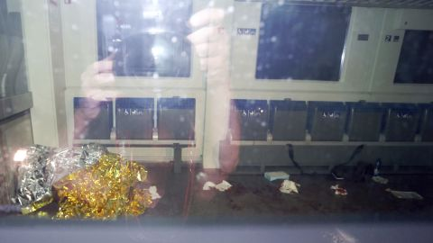 Blood stains and a rescue blanket appear through the windows of the train in Wurzburg. The attacker was identified as a 17-year-old Afghan man living in Ochsenfurt, Germany.