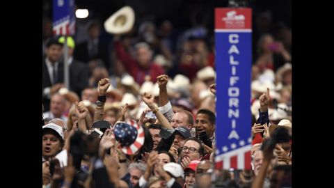 Delegates cheer during the roll call vote on the second day of the Republican National Convention in Cleveland, Tuesday, July 19, 2016.
