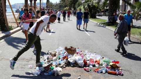 A man spits on the site in Nice where police killed the attacker.