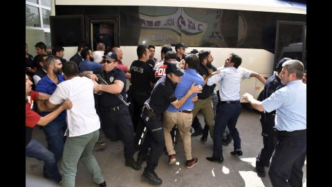 Police try to stop people from attacking a judge, suspected in the failed coup plot, in Erzurum, Turkey on Tuesday, July 19. Turkey has fired or suspended about 50,000 people as the government intensifies a crackdown following last weekend's failed coup attempt. Teachers, journalists, police and judges have been affected.