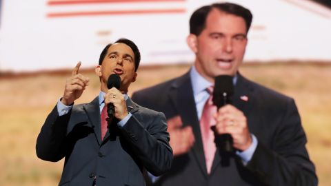 """Wisconsin Gov. Scott Walker delivers a speech Wednesday. """"A vote for anyone other than Donald Trump in November is a vote for Hillary Clinton,"""" the former presidential candidate said."""