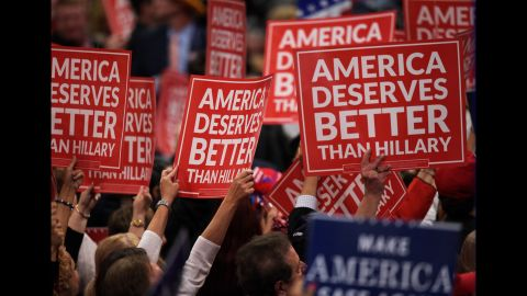 Delegates hold up signs Wednesday.