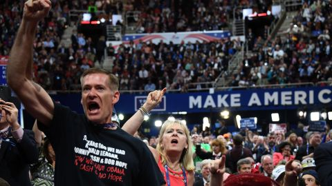 Delegates shout on the floor of the arena on Wednesday.