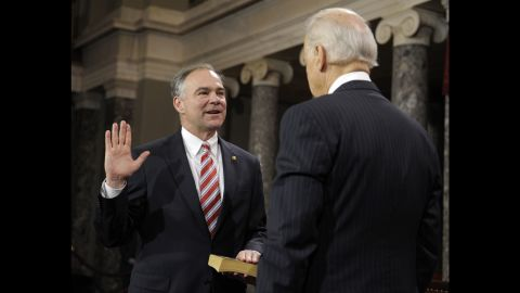 U.S. Vice President Joe Biden, right, administers the Oath of Office to Kaine during a mock swearing-in ceremony in 2013.