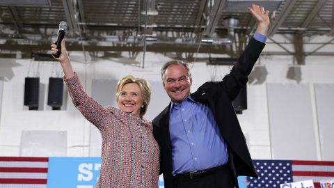 Kaine waves with Hillary Clinton during a campaign event in Annandale, Virginia, on July 14.