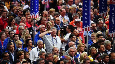 Delegates stand for the national anthem Thursday.