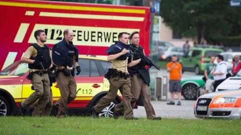 Police walk near the scene of the shooting.
