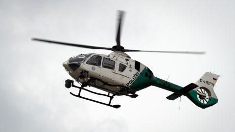 A police helicopter flies over the mall.