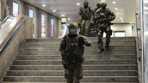 """Police secure an underground transit station after a deadly shooting in Munich, Germany, on Friday, July 22. At least eight people were killed at a nearby shopping mall in what police officials said """"looks like a terror attack."""" Police are still looking for the gunmen."""