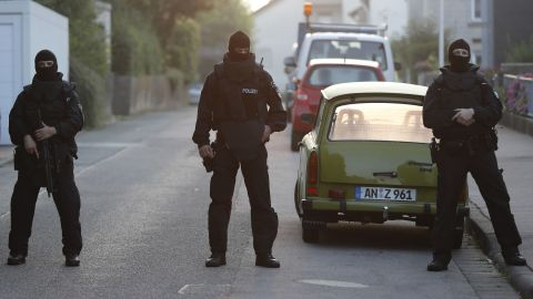 Police officers secure a street near where the bomber lived.