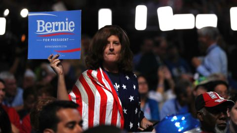 A delegates holds up sign showing her support for Former Democratic Presidential candidate, Sen. Bernie Sanders, I-Vt., during the first day of the Democratic National Convention in Philadelphia , Monday, July 25, 2016. \
