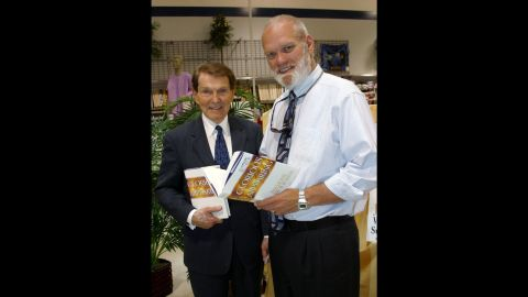 """<a href=""""http://www.cnn.com/2016/07/25/us/left-behind-author-timothy-lahaye-dies/"""" target=""""_blank"""">Timothy LaHaye</a>, the evangelical minister and co-author of the """"Left Behind"""" book series, died July 26 following a massive stroke. He was 90 years old. Here, he is seen at left with co-author Jerry B. Jenkins in 2004."""